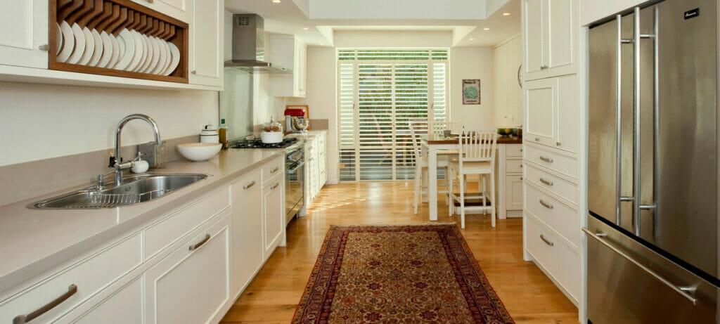 Transitional Galley Kitchen in Caesarstone 2030 Haze 1585
